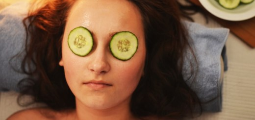 Woman with cucumber over eyes