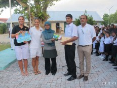 Our winning artist surrounded by our team from Dhuni Kolhu and the school principal from Thulhaadhoo