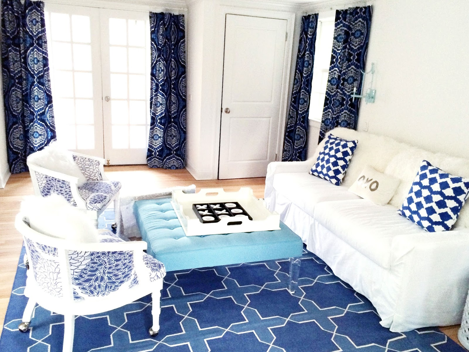 blue and white living room in an east hampton home - Living Room East Hampton
