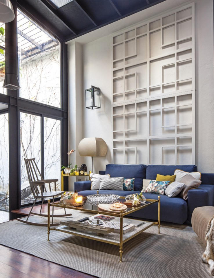 trellis wall art in living room with blue sofa