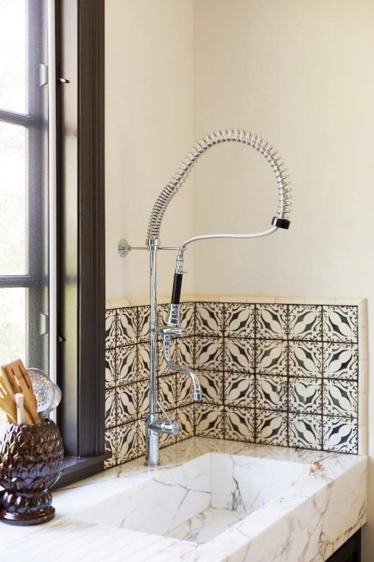 integrated-stone-sink-kitchen-faucent-tile-black-window-trim-cococozy
