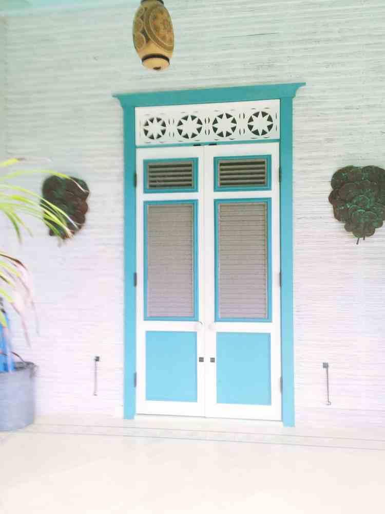 Turquoise blue shutter doors