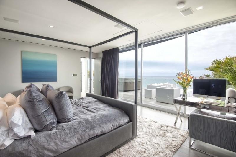 modern beach house master bedroom grey