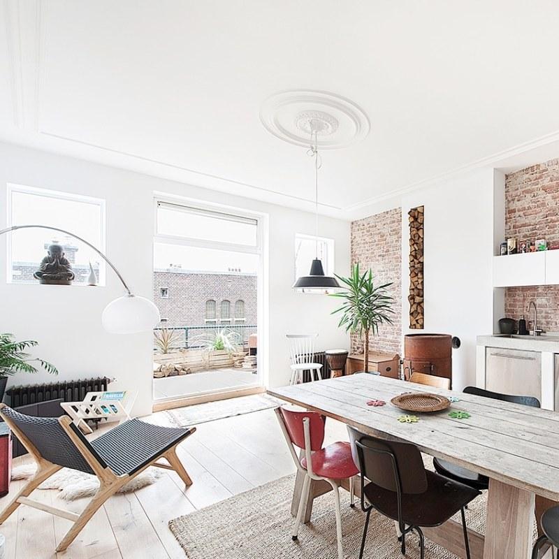contemporary apartment kitchen black pendant light cococozy elledecoration 2