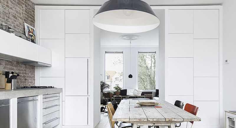 contemporary apartment kitchen black pendant light cococozy elledecoration 3