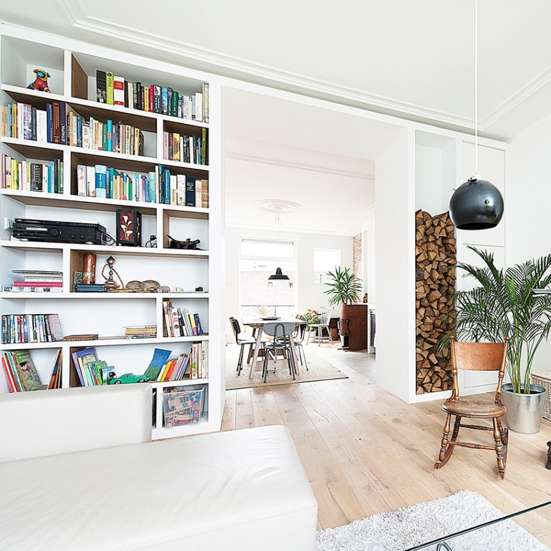 contemporary apartment living room black pendant light cococozy elledecoration 2