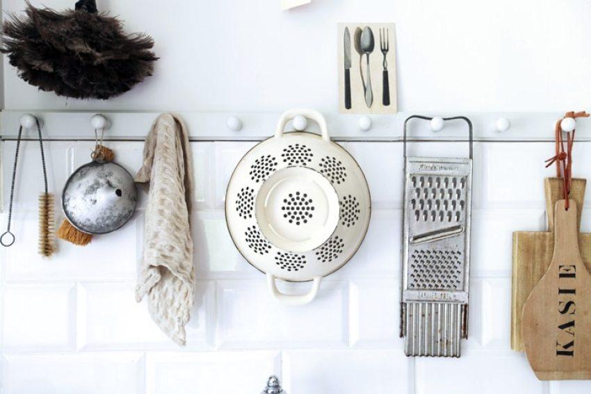 small white kitchen colander wall
