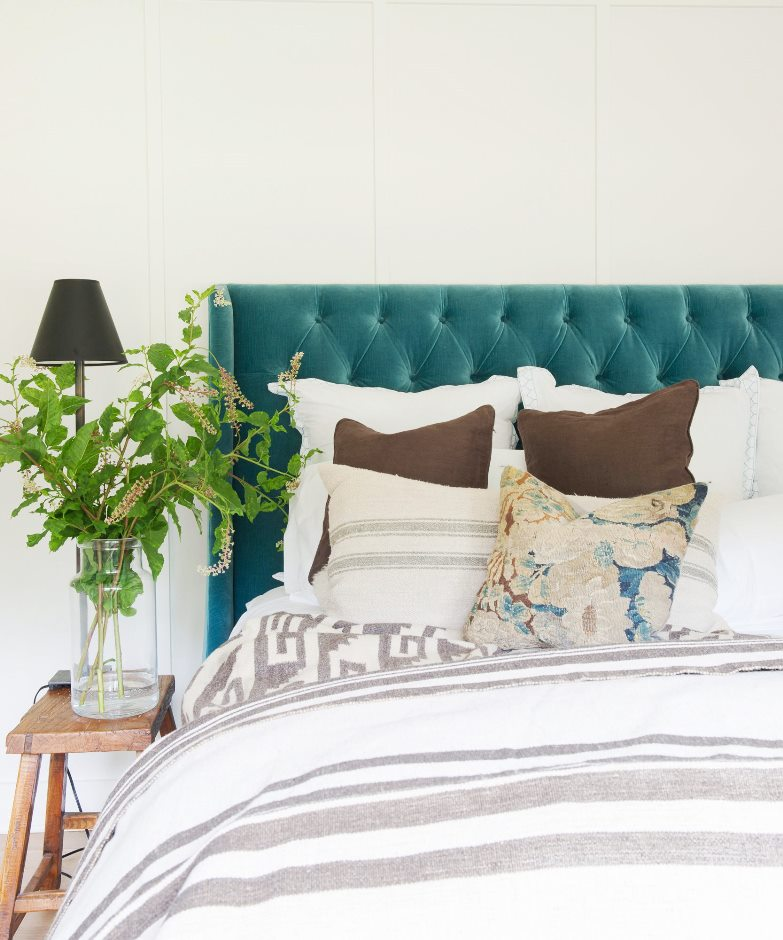 farmhouse bedroom teal blue tufted headboard