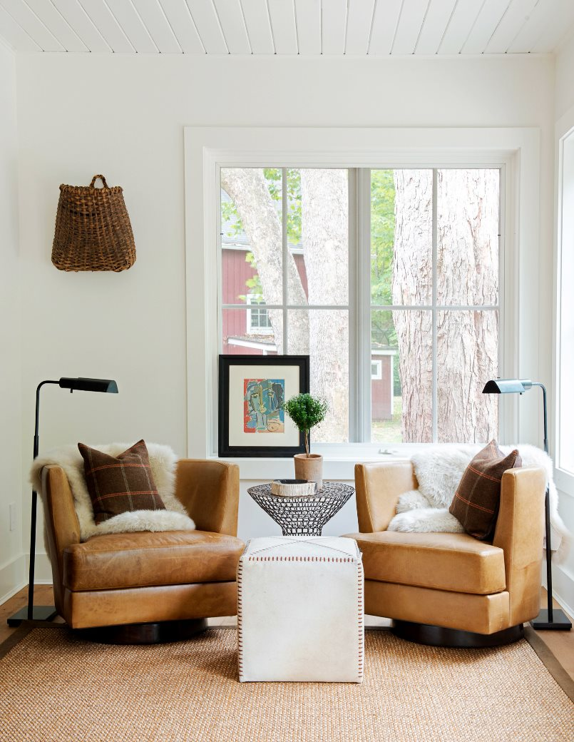 farmhouse-renovation-seating-area-leather-armchairs-cowhide-ottoman-cococozy-nyt