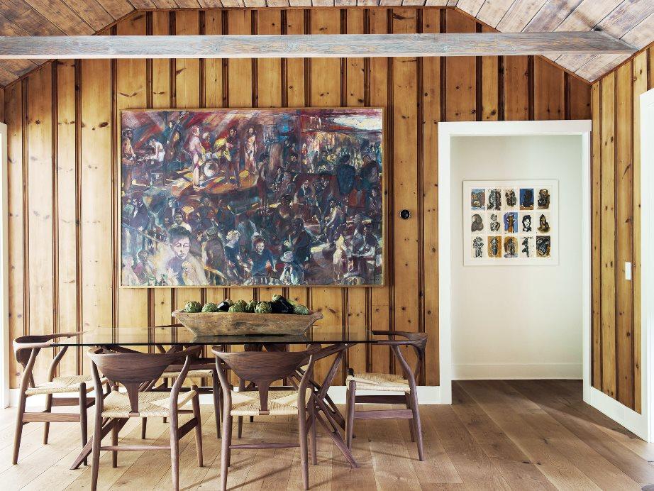 farmhouse dining room wood paneled wall wishbone chairs