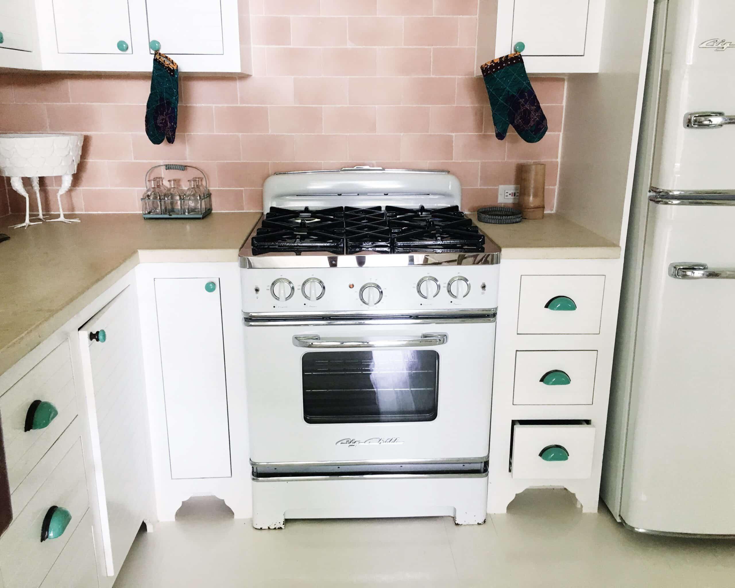 retro kitchen pink tile backsplash white stove big chill range