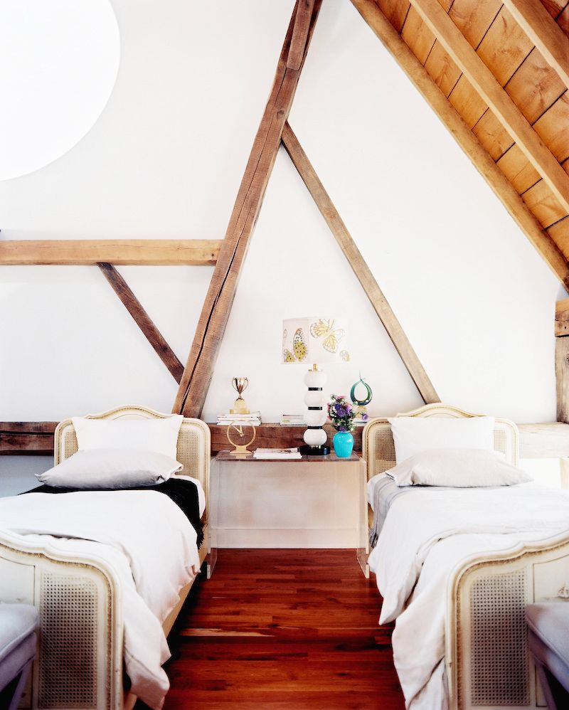 a frame ceiling exposed beam bedrooms double beds white bedding