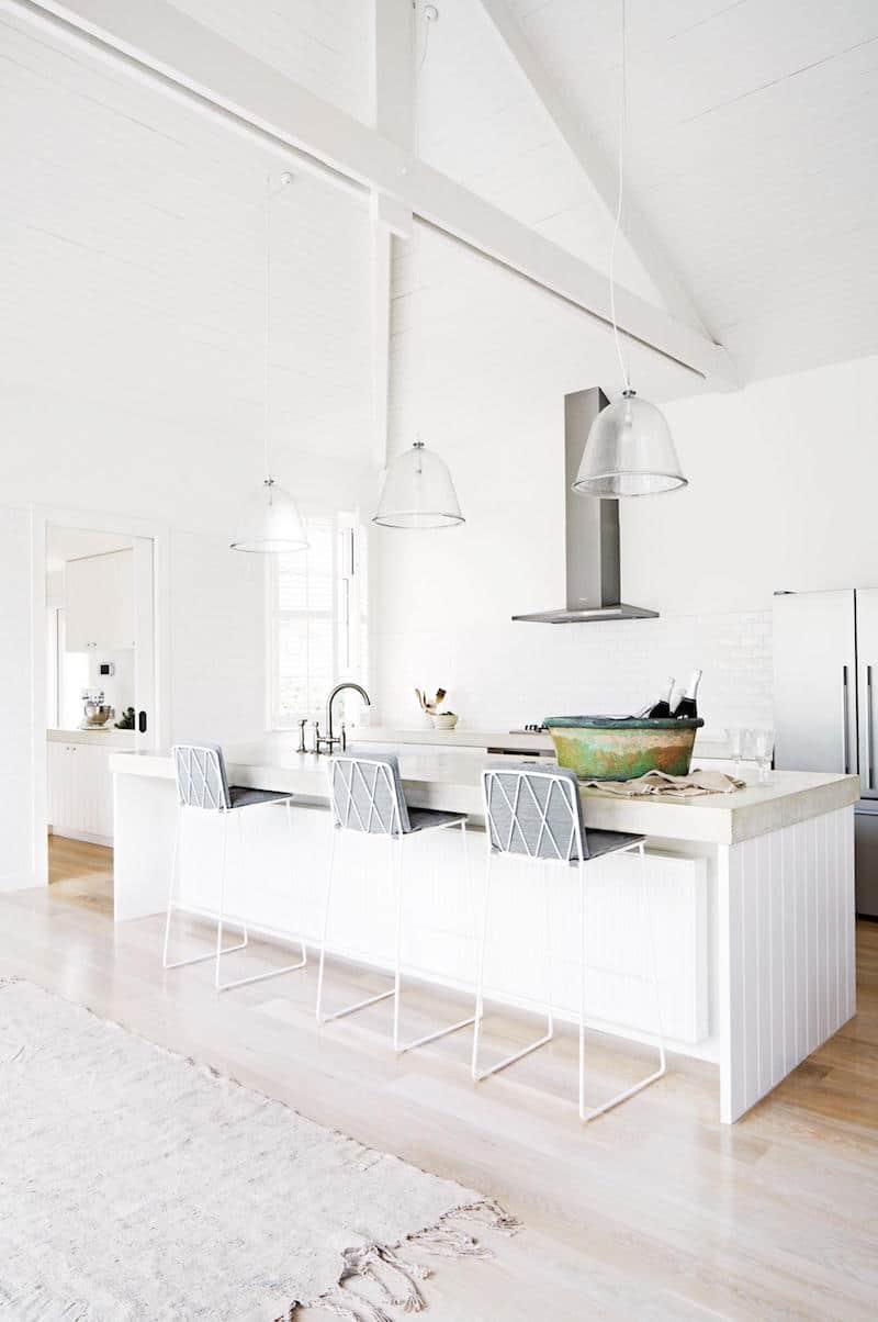 Bright White Kitchen high ceiling open floor plan