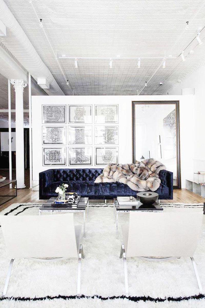lovely loft navy velvet sofa bright white walls