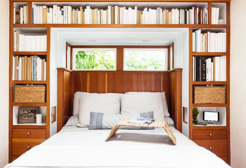 bedroom built in bookshelves cozy cottage los angeles white bedding wooden accents