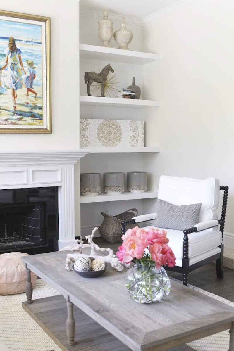 becki owens built in bookshelves pink peonies white fireplace mantel