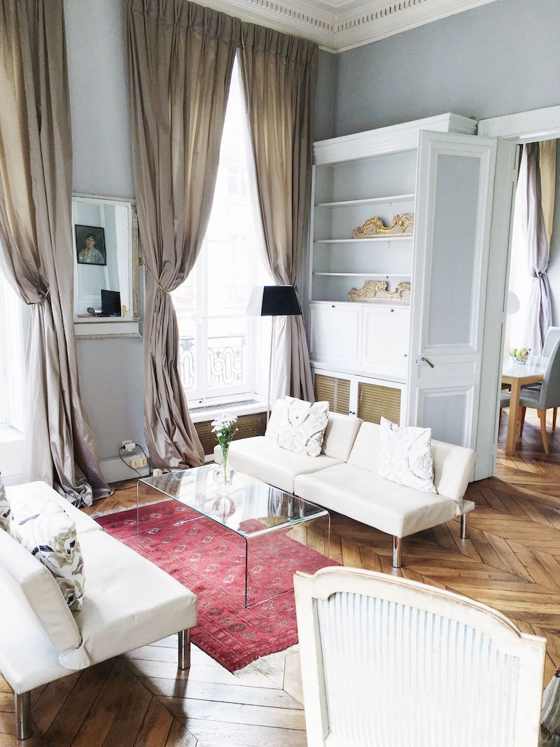 Paris Apartment Living Room White couch herringbone floors