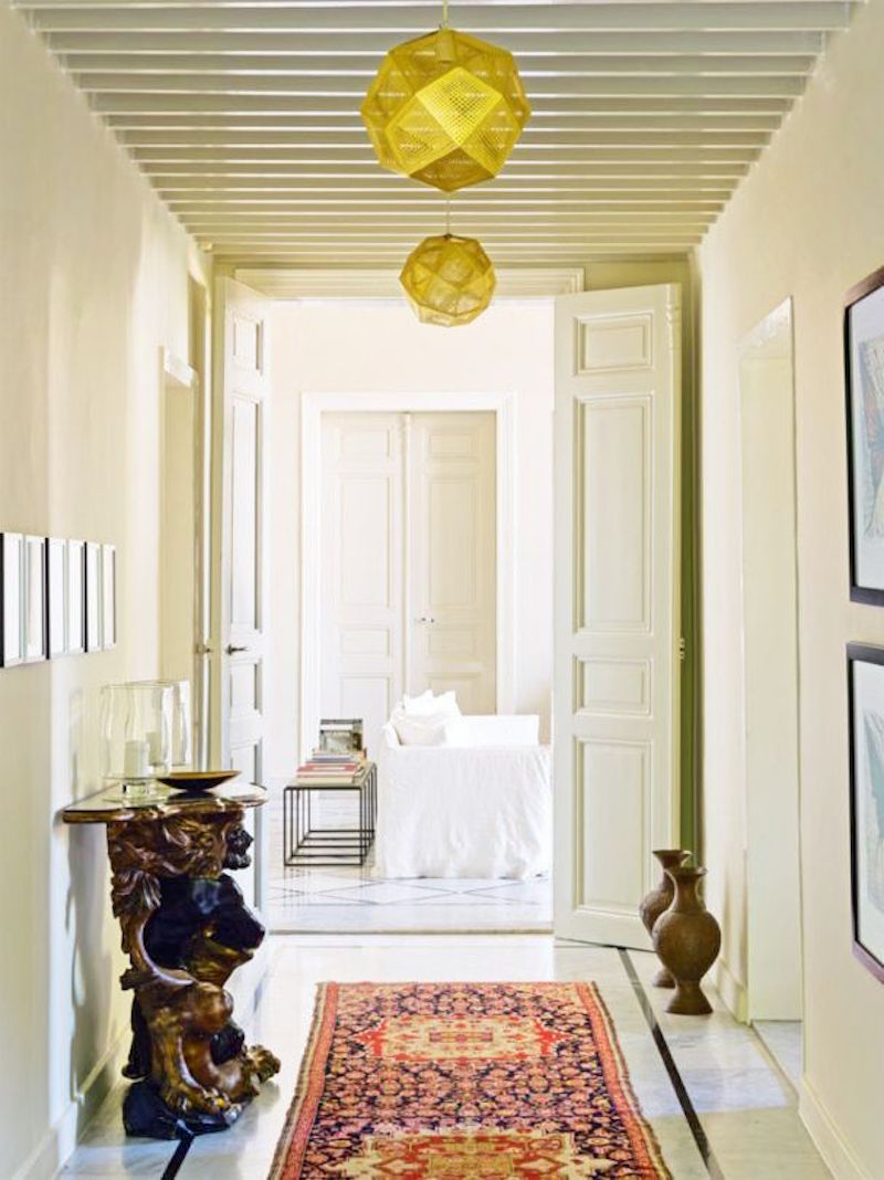 Beirut Home Tour hallway rug gold geometric lanterns