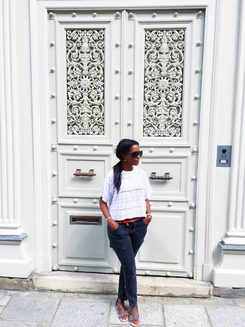 orange fashion accessories orange belt white top blue cargo pants ponytail white door