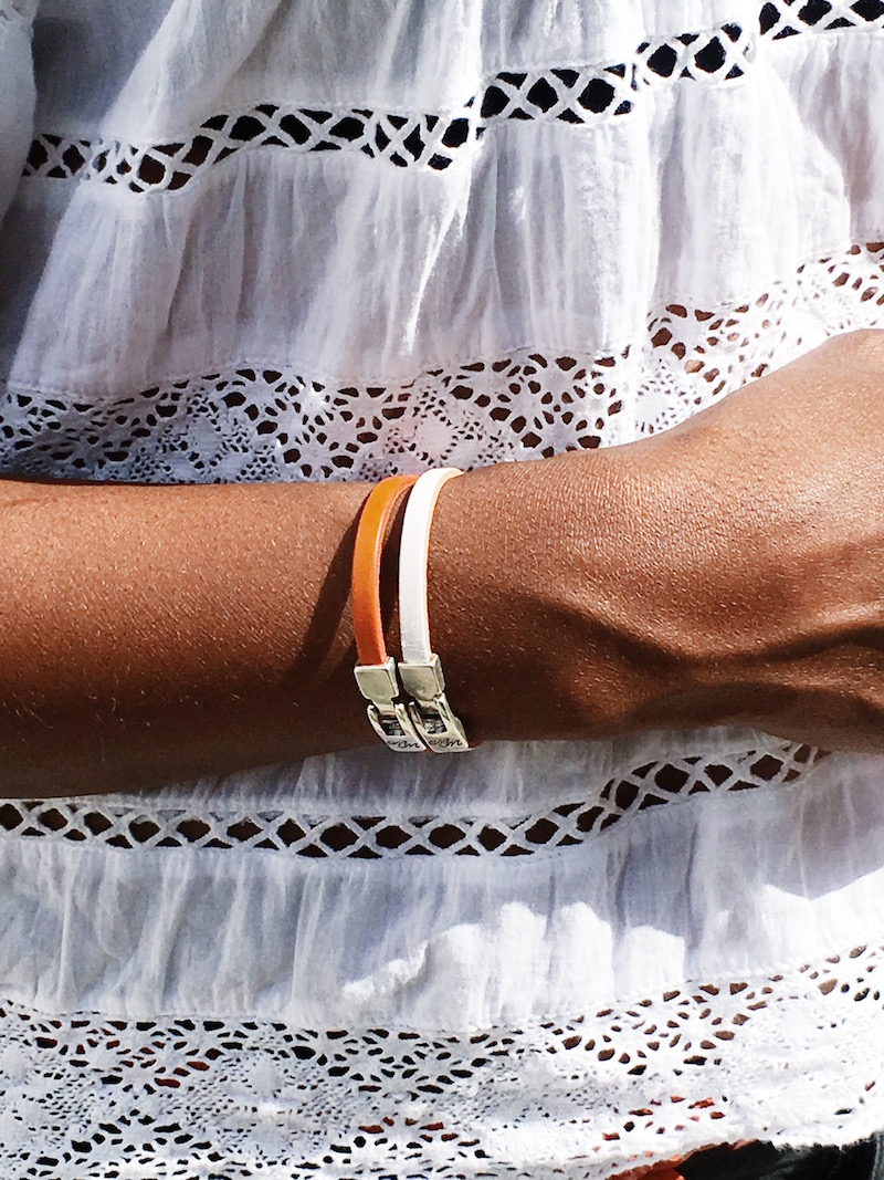 orange fashion accessories orange bracelets white top