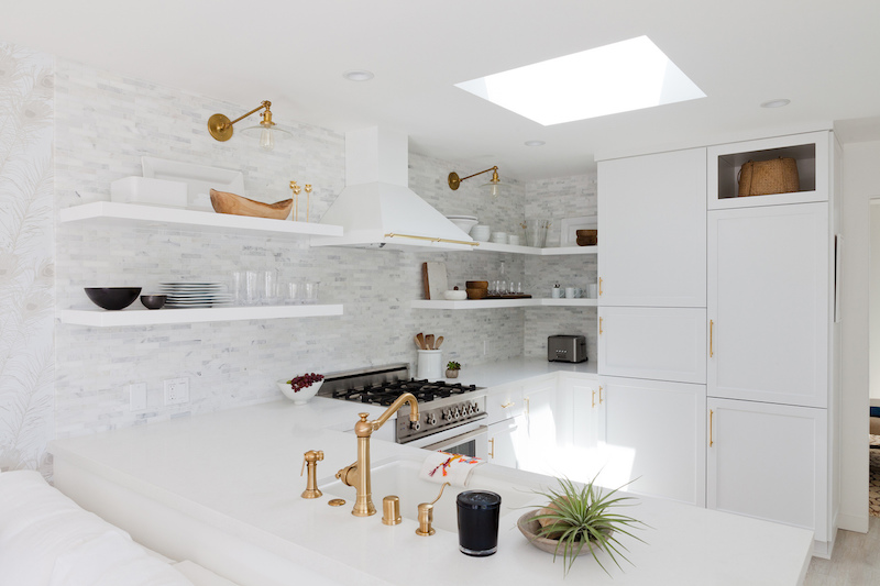 small white kitchen sky light open shelving gold fixtures