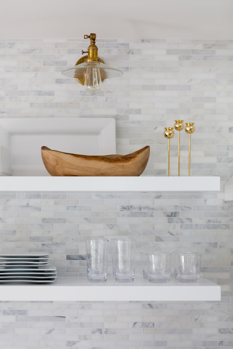 small white kitchen open shelving glassware dishware