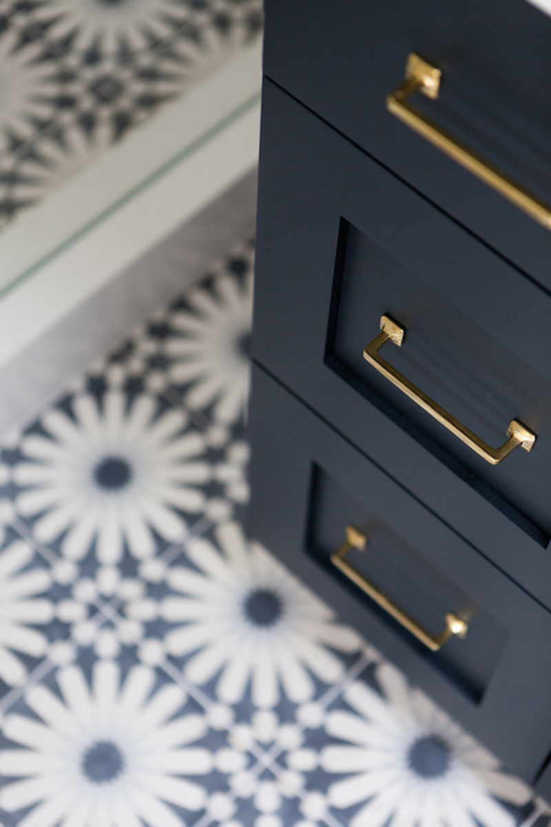 brass handles blue cabinet