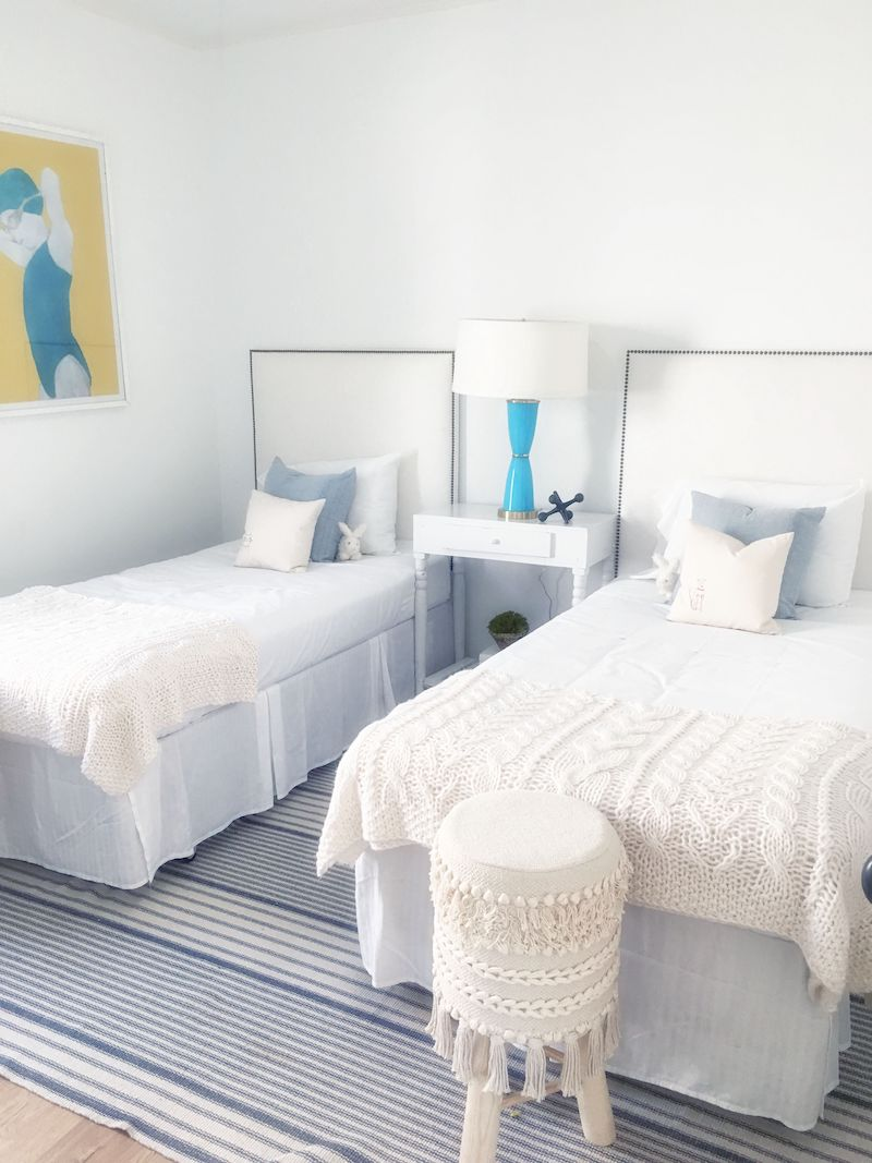 two-twin-bedrooms-cream-blue-beds-stool