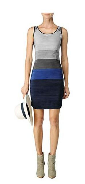 colorblock sleevless dress with silk chiffon layers on a white model wearing grey ankle boots and holding a white hat with a navy band
