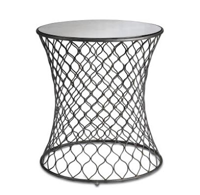 Accent table with wire base bent into curves