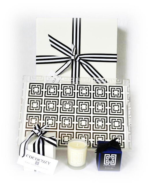 COCOCOZY wrapped box, COCOCOZY Lucite Logo Tray in black and white, COCOCOZY Candles in Black Label and Beach