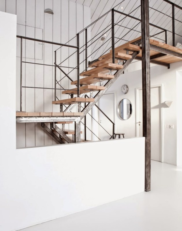 Modern staircase with wood steps and metal banister