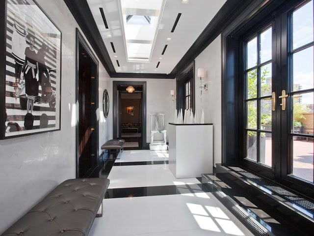 Cococozy Park Avenue Penthouse Apartment real estate listing black and white foyer with a skylight, black and white marble floor, black French doors leading to a patio, and leather benches