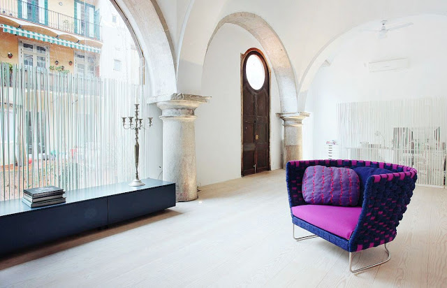 purple and magenta accent chair in a Barcelona cloister turned home