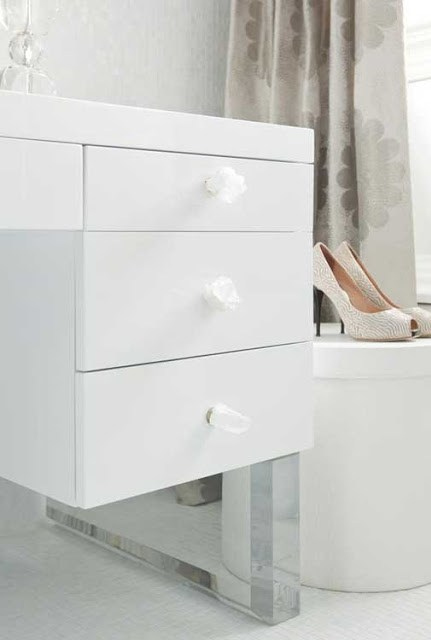 close up of white cabinets in a girly closet