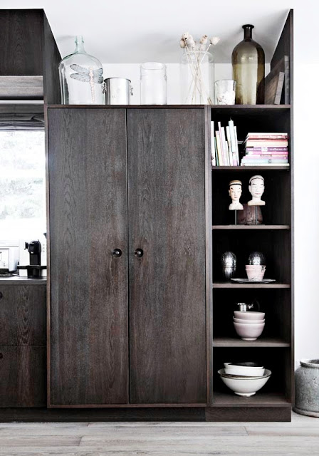 close up of wooden kitchen pantry and shelves