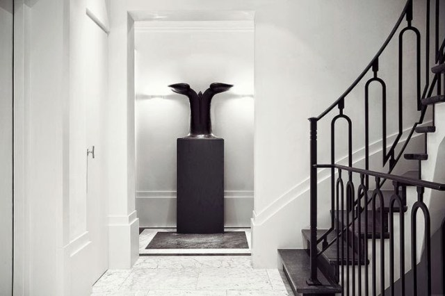 White foyer with black staircase