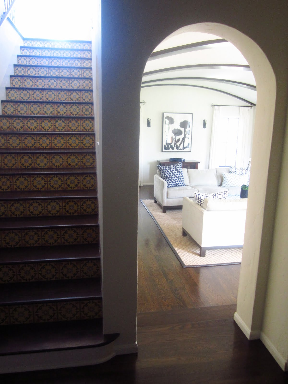 Foyer With Staircase Spanish Tiles And View Into Living Room