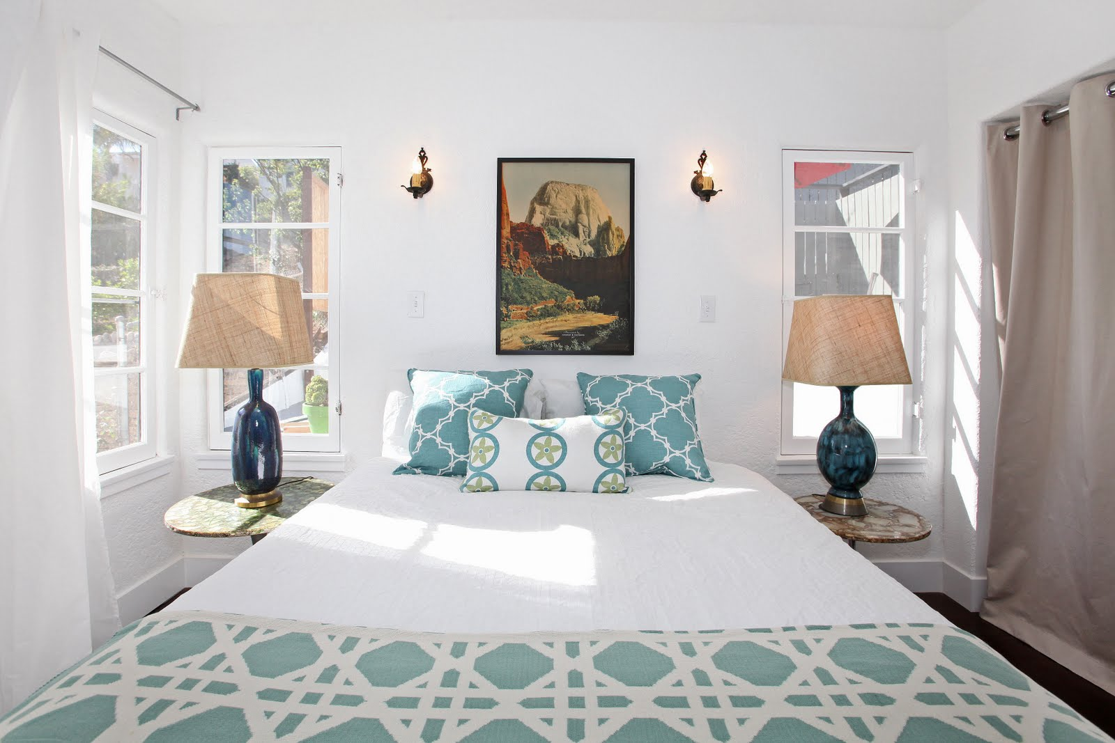 White Bedroom In A Spanish Style Home With Vintage Lamps On Matching Side  Tables, A