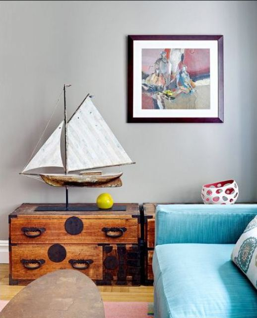 den with blue blue, reclaimed wood trunk as side table with a sail boat weather vane