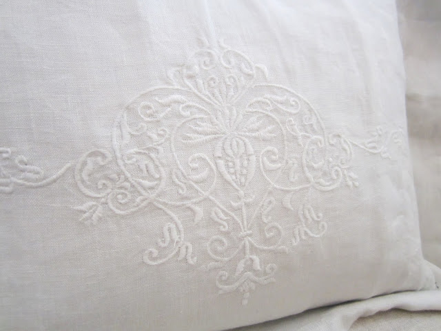 Close up of embroidered details on Pom Pom Interior's bedding