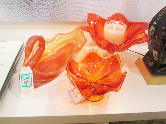 Three vintage orange glass dishes: two flowers and one swan