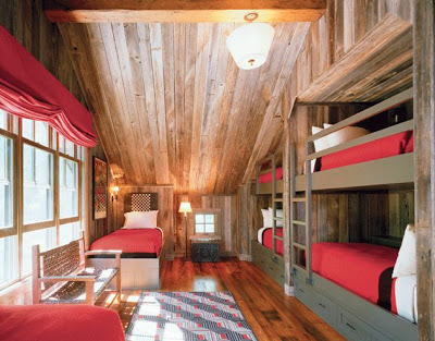Good rustic children us room with wood paneling and bunk beds