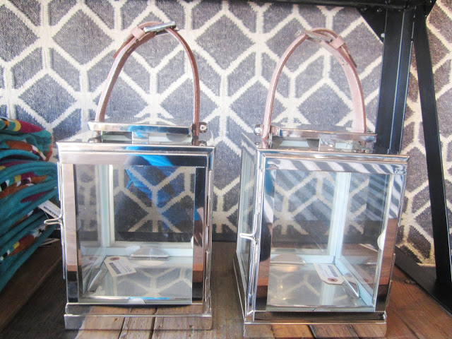 polished metal lanterns with a leather strap