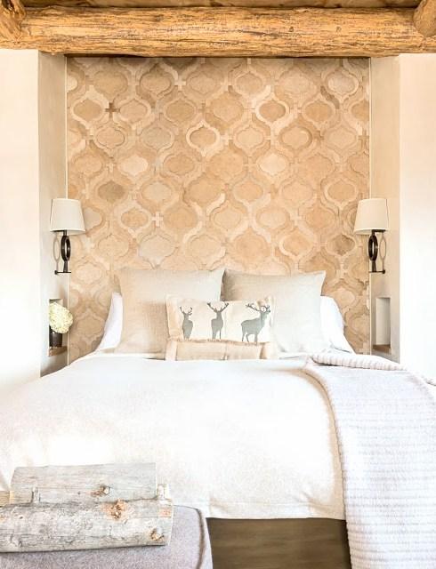 Chic cabin bedroom with a hide rug headboard