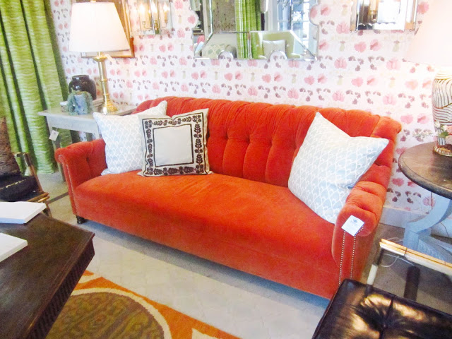burnt orange velvet sofa with nail head trim with white accent pillows