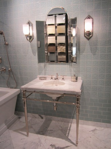 Bathroom with Michael S. Smith's Labyrinth tiles for Ann Sacks from floor to ceiling, an undermount sink where you can see the pipes and a marble tile floor