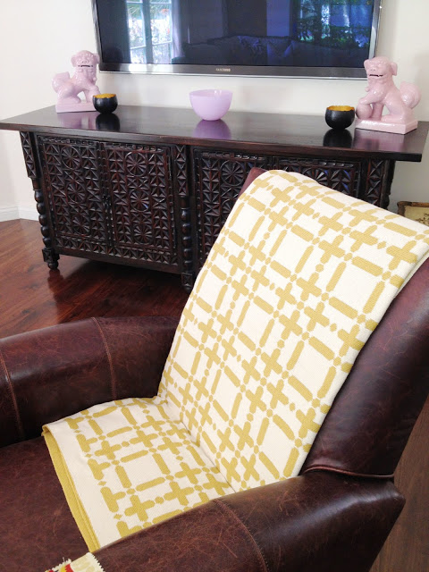 COCOCOZY Plaid Solid Throw in gold on Paula B.'s brown leather chair