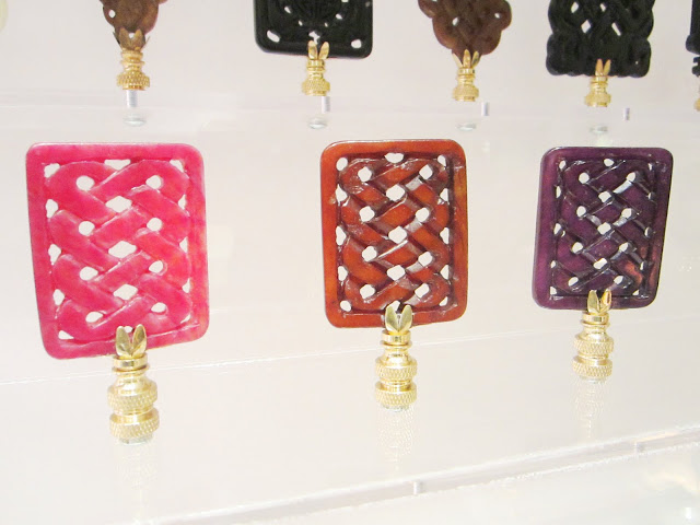 Close up of stone finials in pink, brown and purple