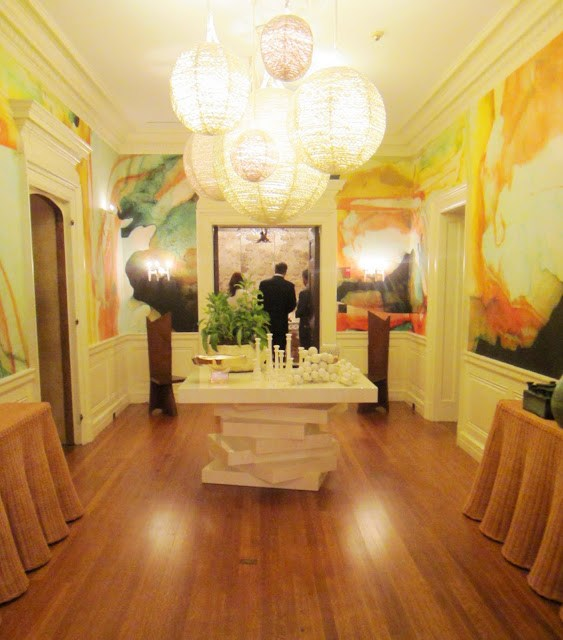 2nd floor hallway at the Maison de Luxe Greystone Mansion with a bold and colorful watercolor wall coverings and rope lighting